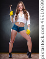 Sexy alluring woman holding hammer. Feminism. 45510599