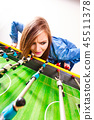 woman playing table football game 45511378