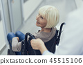 Happy lady is moving on pushchair with doctor help 45515106