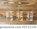 Three tubes of water, oil and alcohol  45515145
