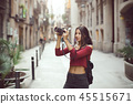 Beautiful Tourist Woman Taking a Picture Outdoor in City Street by Digital Camera 45515671
