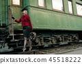 Retro woman on the train station 45518222