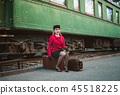 Retro woman on the train station 45518225