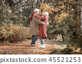 Delighted nice couple of pensioners dancing waltz 45521253
