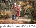 Happy delighted couple dancing in the forest 45521256