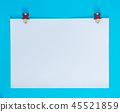 white square sheet of paper on a blue background 45521859