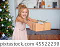 Holidays, presents, christmas, x-mas concept - happy child girl with gift box 45522230