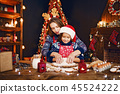 Merry Christmas and Happy Holidays. Mother and daughter cooking Christmas cookies. 45524222