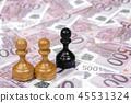 chess pawns on euro money 45531324