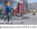 woman with trolley at a supermarket 45531336