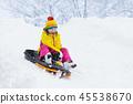 Girl on sled ride. Child sledding. Kid on sledge 45538670
