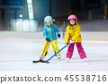 Children play ice hockey. Kids winter sport. 45538716