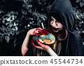 Demon witch take care of pumpkin in the mystery forest. Ghost an 45544734