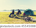 Group of travelers camping and doing picnic and playing music to 45545088