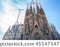 Frontal view of Sagrada Familia. cranes are still working 45547347