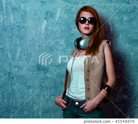Redhead grunge girl with headphones 45548878