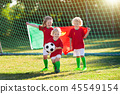 Portugal football fan kids. Children play soccer. 45549154