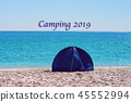 Small Blue Shade Tent On White Silica Sand Beach  45552994