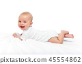happy beautiful baby girl in white body suit 45554862
