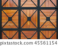 wooden gate with wrought iron as background 45561154