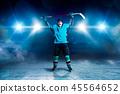Hockey player raised his hands up, winner 45564652