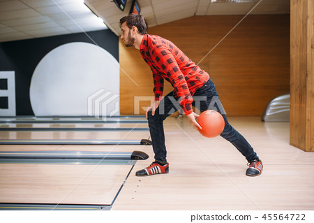 Bowler makes throw, closeup view on hand with ball 45564722