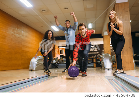 Male bowler throws ball, throwing in action 45564739