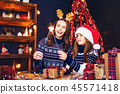 holidays, family and people concept. Happy mother and little girl in santa helper hat with sparklers 45571418