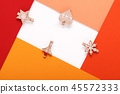red paper card on a christmas clothes peg 45572333