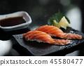 Salmon sushi on black plate japanese food 45580477