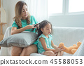 mother Braiding hair To her daughter  45588053
