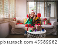 Daughter kissing on cheek after give a box of gift 45589962
