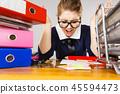 Depressed businesswoman sitting at desk 45594473
