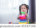 Little girl playing small toy hoop in home. Education and Happin 45597166