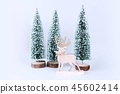 Christmas wooden tree with reindeer over light blue background. 45602414