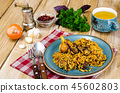 Blue plate with pilaf and meat 45602803