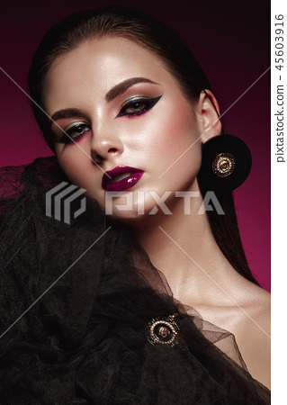 Beautiful girl with bright creative make-up and graphic arrows. Beauty face. 45603916