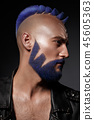 Young man with blue hair and creative makeup and hair. 45605363