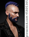 Young man with blue hair and creative makeup and hair. 45605365