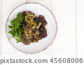 Fried chicken liver in batter on plate with greens 45608006