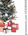 Decorated Christmas tree with gift wrapped present 45608099
