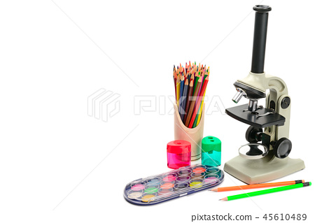 Microscope and other school supplies isolated  45610489