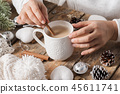 Girl sitting at her desk drinking coffee 45611741