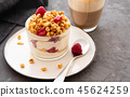 Fresh yoghurt with rasberries and coffee in clear glass. Raspberries in white bowl. Healthy morning 45624259
