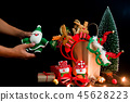 Man hands holding Santa Claus toy,Christmas 45628223