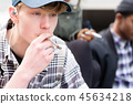 Portrait of young boy smoking 45634218