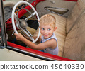 Kid sitting on old American car 50s / 60s 45640330