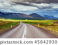 Asphalt road to the mountains. Iceland. 45642930