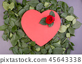 Holiday background, Valentine's day. Box in the shape of a red heart decorated with a red rose on a 45643338