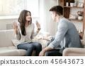 Emotional brunette female raising her both hands 45643673